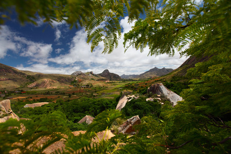 anja: Green valley with rice fields and mountains with rocks. Madagascar