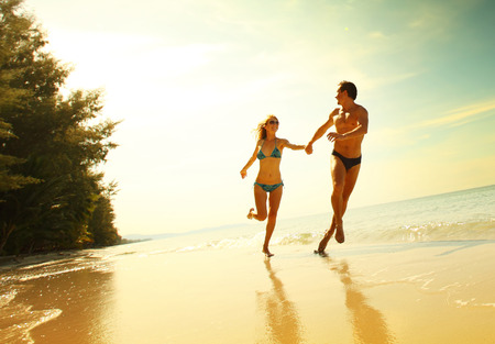 love hot body: Young couple having fun on the tropical beach at sunny day