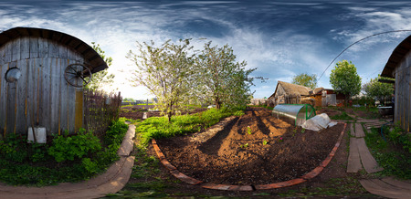 equirectangular: Panorama of a spring blooming garden in a village at sunset  Equiregtangular projection Stock Photo
