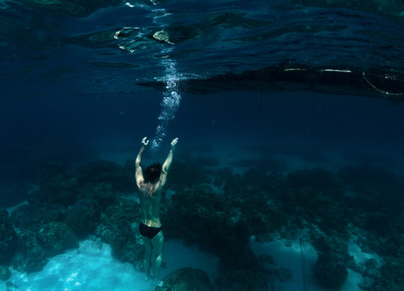 Underwater shot of the man drowning in the sea