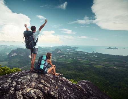 woman mountain: Hikers standing on top of the mountain
