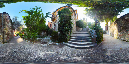 equirectangular: Spherical, 360 degrees panorama of the green yard in the city of Verona, Italy