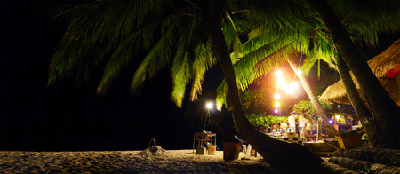 beach bar: Bar on a tropical beach among palm trees at night. Koh Chang, Thailand Stock Photo
