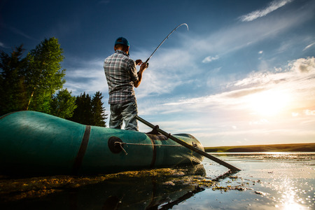 lure: Mature man fishing from the boat