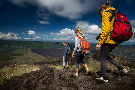 volcano slope: Group of hikers descending on friable ground in the caldera of volcano of Batur. Bali, Indonesia