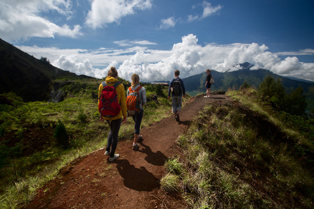 backpackers: Group of hikers walking in the caldera of volcano of Batur, Bali, Indonesia