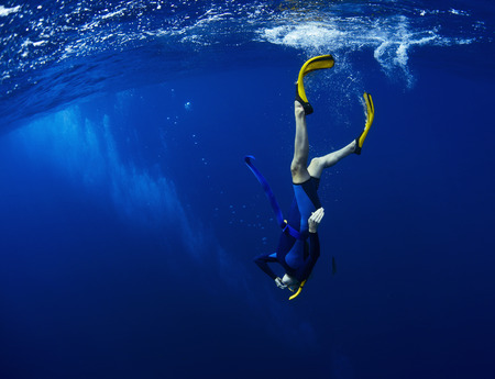 free diver: Free diver performing equalization at the beggining of the dive