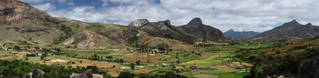 anja: Panorama of the green valley with rice fields and villages among mountains. Anja reserve, Madagascar