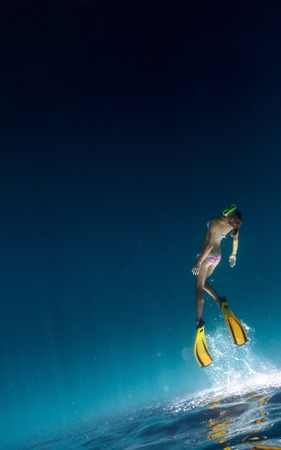 bottomless: Underwater shot of the lady freediving in a sea