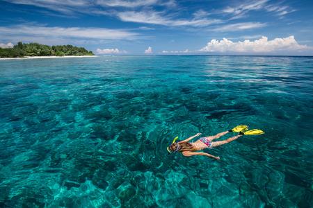 snorkeling: Lady snorkeling in turquoise water near Gili Trawangan island, Indonesia Stock Photo