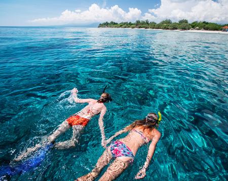 snorkeling: Two ladies snorkeling in the clear tropical sea near the island of Gili Trawangan, Indonesia