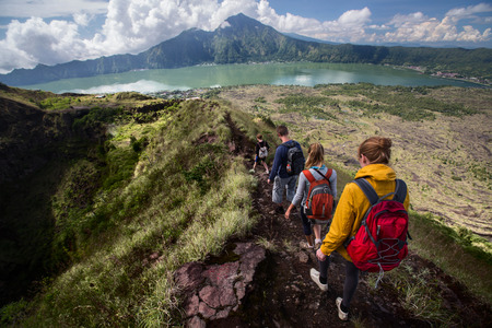 Group of hikers walking on the caldera of volcano of Batur, Bali, Indonesia