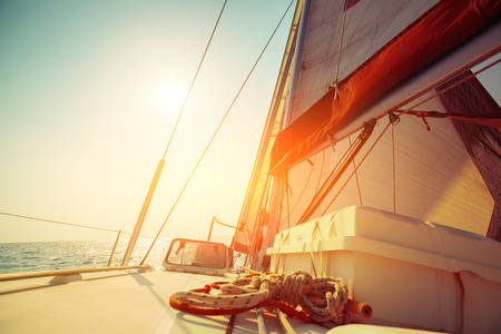 sailing yacht: Sail boat in an open sea at sunny day