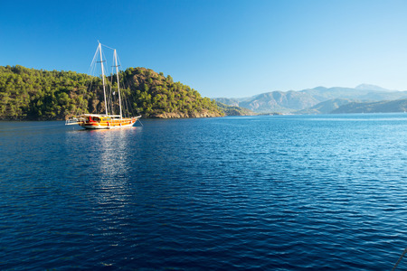 Traditional sail boat anchored in the calm bay of Skopea Limani, Turkey