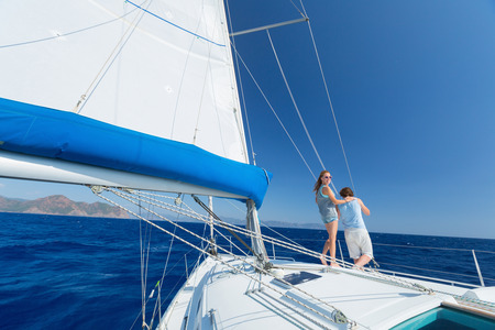 cordage: Young couple sailing in Mediterranean sea at sunny day