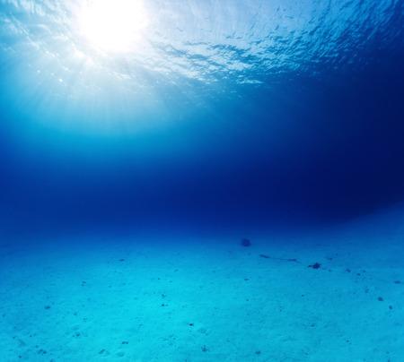 Underwater shot of the sandy bottom Stock Photo