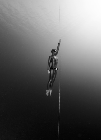 free diving: Free diver ascending along the rope. Free immersion discipline