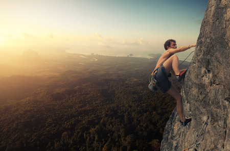 sunrise mountain: Climber Stock Photo