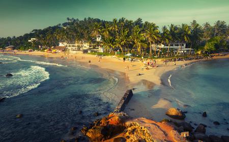 Tropical beach in the town of Mirissa, Sri Lanka Stock Photo - 35322487