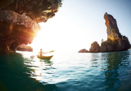 woman alone: Young lady paddling the kayak Stock Photo