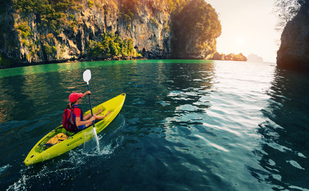 solitude: Woman with the kayak Stock Photo
