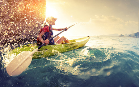 at sea: Woman with the kayak Stock Photo