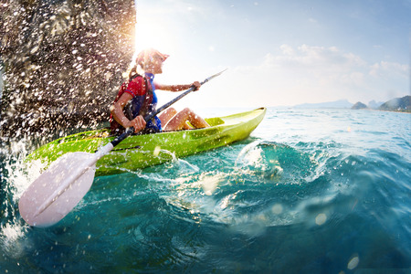 outdoor activities: Woman with the kayak Stock Photo