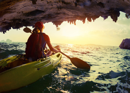 cave: Woman on the kayak Stock Photo