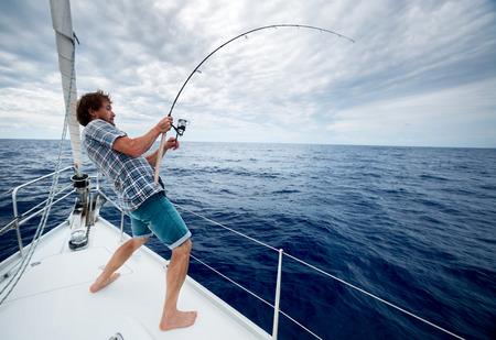 hombre pescando: Pescador