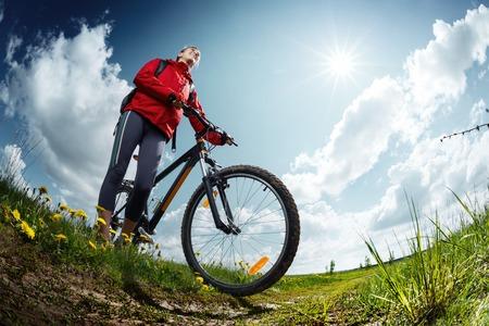 aim: Hiker with bike