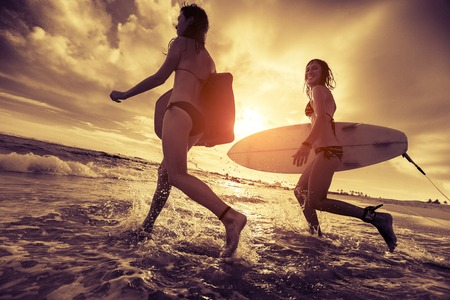 Surfers with boards