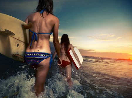 bare girl: Surfers with boards
