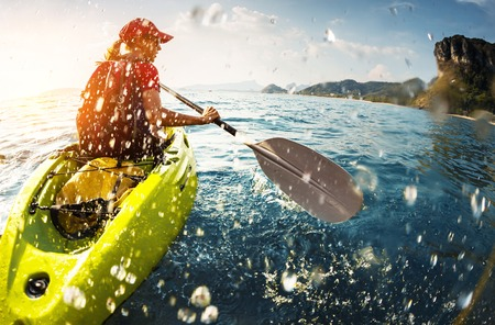young lady paddling the kayak stock photo picture and royalty free