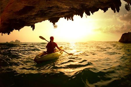 Young lady paddling the kayak 写真素材