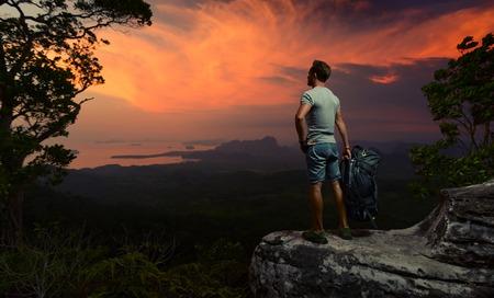 backpacks: Hiker on the rock