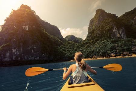 long bay: Lady exploring Ha Long Bay   by kayak. Vietnam