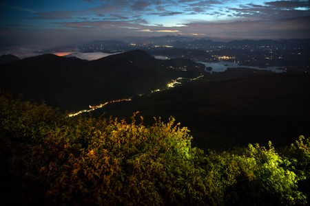 valley view: Night valley with illuminated villages. View from Adams Peak, Sri Lanka