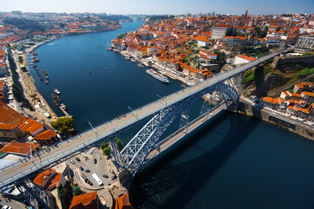 Aerial shot of the metal arch brige (Dom Luise bridge) between the city of Porto and the city of Vila Nova de Gaia at sunny day. Portugal