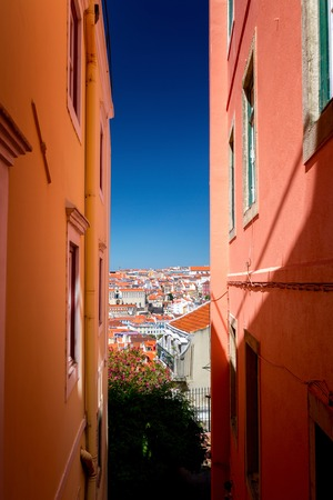 old houses: Narrow street in the city of Lisbon Stock Photo