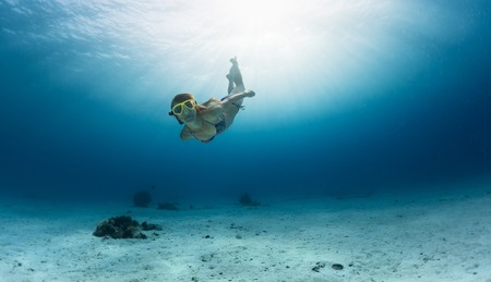 skin diving: Skin diving in the ocean. Underwater shoot Stock Photo