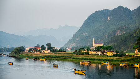 river: Calm river with boats in the National Park of Phong Nha Ke Bang, Vietnam