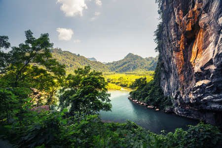 clear day: Clear river flowing from the cave in the National Park of Phong Nha, Vietnam