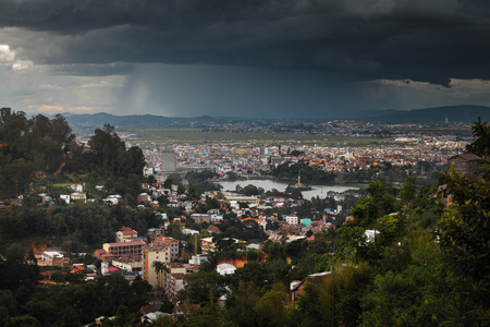 rain shower: The city of Antananarivo with heavy rain shower on the horizon. Madagascar