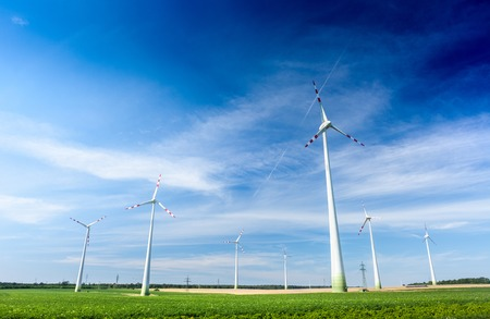 wind mill: Wind generators in the green field at sunny day