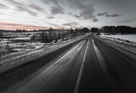 mud snow: Dirty asphalt road with mix of snow, sand and salt Stock Photo
