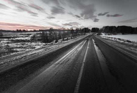 sleet: Dirty asphalt road with mix of snow, sand and salt Stock Photo