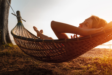 relaxing beach: Lady relaxing in the hammock on the beach
