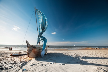 Traditional Malagasy sail boat on the sea coast. Town of Morondava, Madagascar