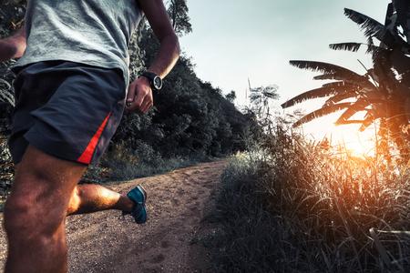 wet t shirt: Man athlete running on the gravel road Stock Photo
