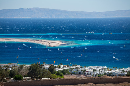 windsurfers: Lagoon full of windsurfers in the town of Dahab, Egypt